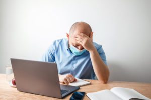 Frustrated worker with laptop