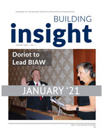 Cover of January 21 Building Insights w/ man in suit and red tie with right hand raised to take the oath of office